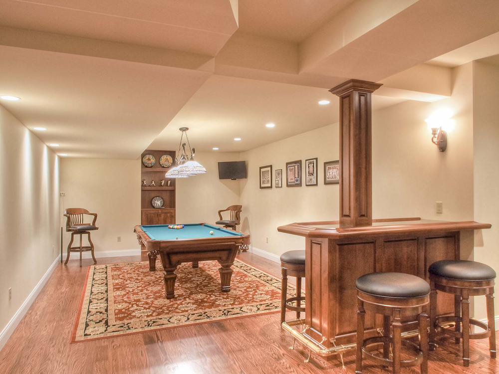 custom basement with pool table